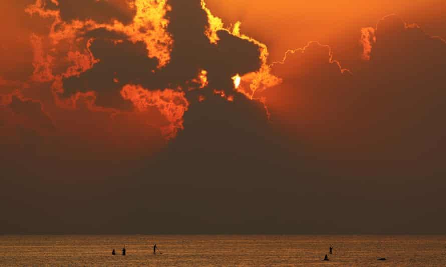 Sun through clouds at beach