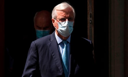 Michel Barnier wears a face mask as he leaves Europe House, headquarters of the EU delegation, in London
