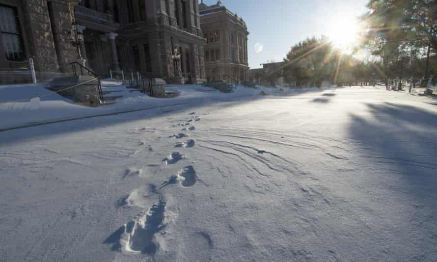 The south steps of the Texas capitol in Austin are covered in snow on 15 February.