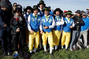 French fans in traditional costume.