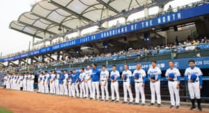 Players from Fubon Guardians fall silent for the victims of the crash prior to the CPBL game between CTBC brothers and Fubon Guardians at Xinzhuang baseball stadium in New Taipei City