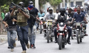 Armed off-duty police officers in Port-au-Prince, Haiti, on 23 February.