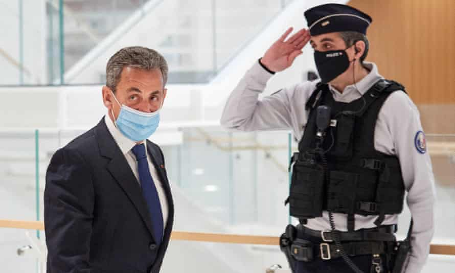 The former French president Nicolas Sarkozy leaves court in Paris after being found guilty on Monday of corruption and influence-peddling.