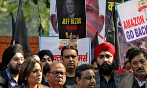 Members of the Confederation of All India Traders protesting against Jeff Bezos's visit in Delhi. Signs read: 'Jeff Bezos go back!' and 'Amazon –go back'