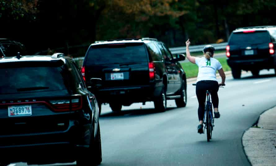 The woman repeated her gesture once she had caught up with the motorcade.