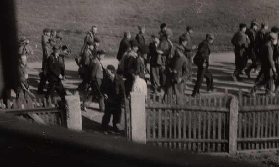 Clandestine image of a forced march.