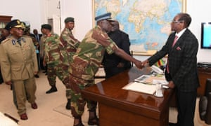 Robert Mugabe meets with defence forces generals in Harare on Sunday.
