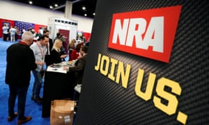 Attendees sign up at the National Rifle Association (NRA) booth at the Conservative Political Action Conference (CPAC) annual meeting in Maryland in February.