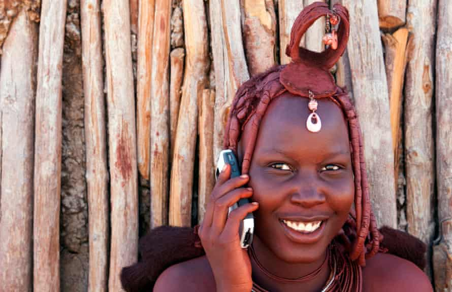A Himba tribeswoman makes a call from a remote region in Namibia.