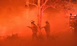 Firefighters struggling against strong winds and flying embers near the town of Nowra, NSW 31 December 2019.