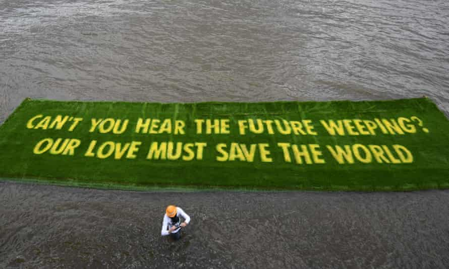 Message reads: Can't you hear the future weeping? Our love must save the world