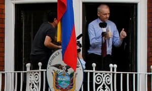 Assange standing at window