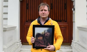 Richard Ratcliffe outside the Iranian embassy in London with a picture of his wife and daughter