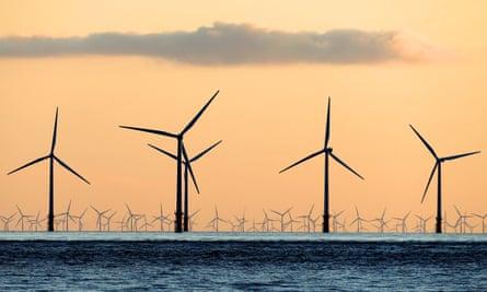 Wind turbines seen from a beach