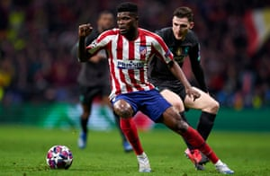 Thomas Partey in action against Liverpool's Andy Robertson in the Champions League last-16 first leg.