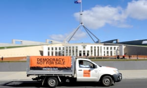 A ute is driven around Parliament House in 2009 by GetUp, calling for changes to political donations