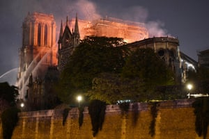 The flames burning the roof of the Notre-Dame Cathedra
