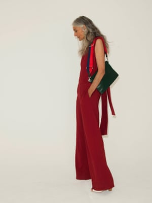 Red sleeveless jumpsuit Cos, white high heeled shoes Reiss, green bag with blue and red strap, Stories