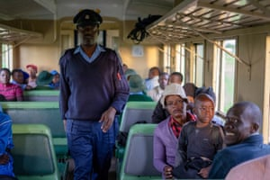 A Zimbabwe National Railways security officer conducts a routine ticket check.