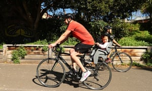 man and baby riding a bike