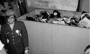 Steve Dahl beside the dumpster full of records collected for Disco Demolition Night.
