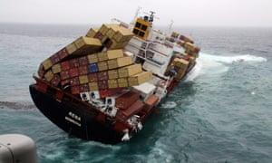 A container ship runs aground in rough seas