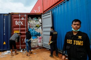 Batam, Indonesia. Customs officers examine one of 65 containers full of imported plastic rubbish, at the Batu Ampar port. Indonesia returned five other containers of rubbish to the United States and said it would not become a 'dumping ground', officials said