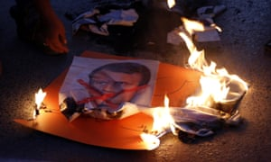 A picture of Emmanuel Macron burns in Islamabad