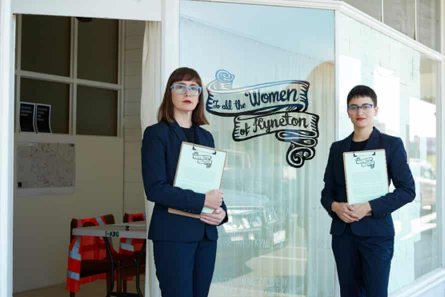 """two women stand in front of a shopfront that says """"to all the women of kyneton"""""""