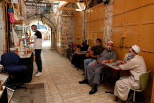 People wearing masks in the Old City district of Hebron