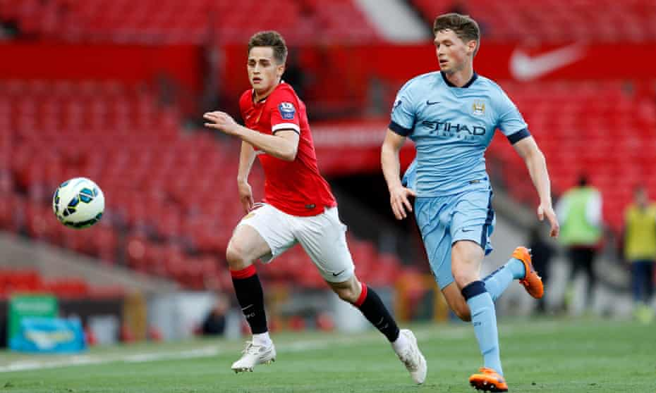 Manchester United's Adnan Januzaj, left and City's George Evans