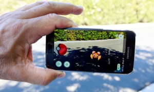 A Pokémon appears on the pavement using the augmented reality of Pokémon Go.