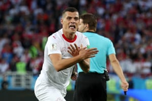 Xhaka of Switzerland celebrates scoring.
