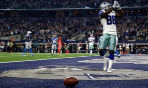 Dez Bryant celebrates after catching a touchdown pass against the Lions.