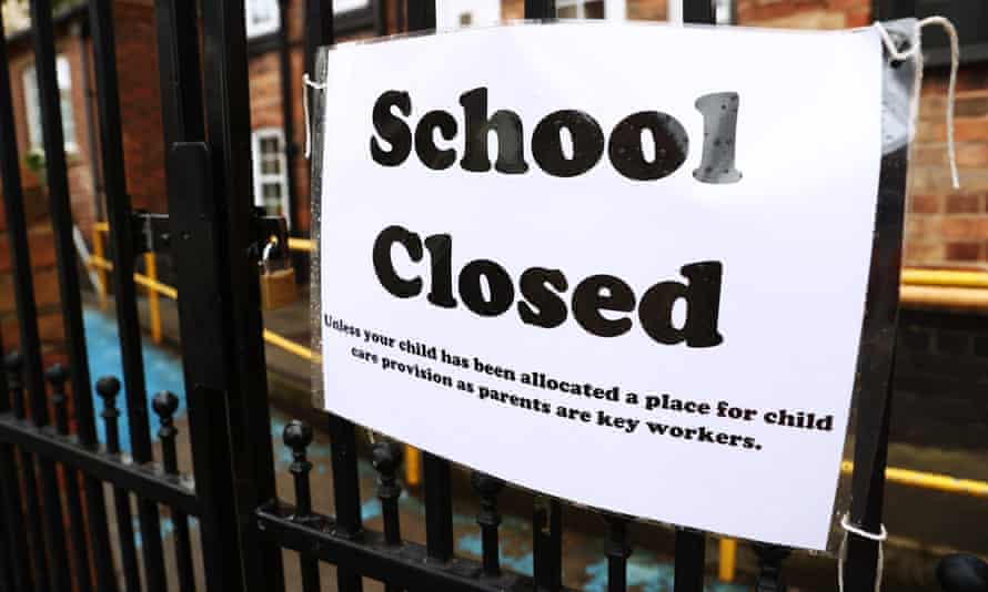 A sign is seen outside a closed school