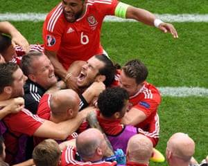 Gareth Bale is mobbed after the opening goal.