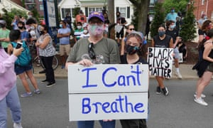 """Jeff Austin and his daughter Lily Henry-Austin of Silver Spring, hold a sign reading """"I Can't Breathe"""" as they protest police brutality against African Americans in Bethesda, Maryland on 2 June."""
