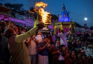 Haridwar, India: devotees attend morning prayer on the banks of Ganges during Kumbh Mela