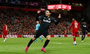 Salzburg's Takumi Minamino celebrates scoring their second goal.