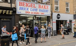 Exterior of Beigel Bake, London, with people walking past.