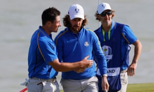 Tommy Fleetwood and Viktor Hovland react on the 8th green after winning the hole.