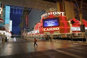 A man walks along a usually busy Fremont Street in March, after casinos were ordered to shut down in Las Vegas.
