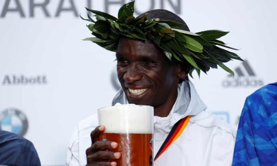 Kenya's Eliud Kipchoge enjoys a well-earned stein of beer after winning the Berlin Marathon.