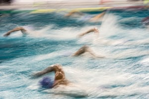 The Dutch men's water polo team swim for the ball during a World League match against Croatia in Eindhoven, Netherlands, in 2017