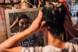 A performer getting ready backstage at a Chinese opera