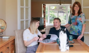 University of Hull BA Business and Marketing student Emily Brown at home with her parents, Malcolm and and Sharon Brown in Lowdham, Nottinghamshire. Emily is showing her Dad a book given to her by Jaguar Landrover during her placement year with the company.