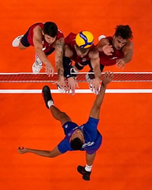 Stephen Boyer of France in action with Torey DeFalco , David Smith and Matt Anderson of the United States during their volleyball match.
