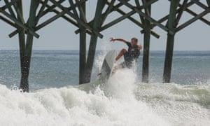 A surfer in Surf City, North Carolina in 2016.