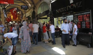 People walk by a foreign exchange shop in Istanbul.