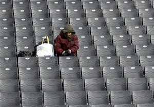Watching the Olympics isn't always a sociable event. This fan sits alone prior to the women's slopestyle qualifying